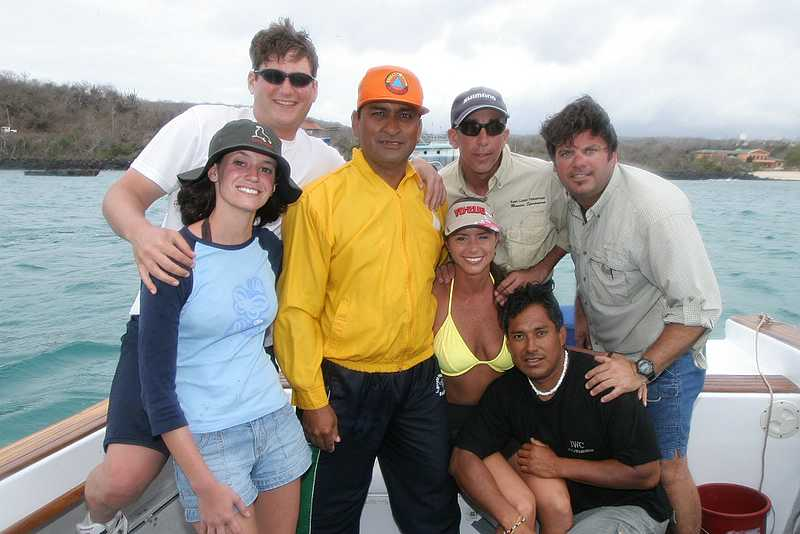 Tuesday, January 10, 2006<br /> <br /> We have been out fishing for three days now and the Captain of the boat, Simon Alcedo finally descends from the bridge for the first time to take part in a group shot with the whole crew.  We have started a new tradition on the boat of leaving a part of yourself in the Galapagos, such as your favorite lure.  In our case, we left behind an autographed fighting belt from our trip.   Angela Vitale