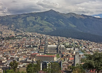 Downtown Quito, Ecuador.  Basilica del Voto Nacional Cathedral is the foreground