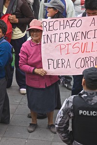 A native older women protests government intervention in the provision and use of water in native areas of Ecuador