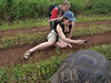 Paul and Louise photographing a giant tortoise in the highlands by Santa Rosa