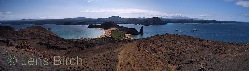 The view towards the west, from the top od Bartolomé, The peninsula with its pinacle is very famous and probaly appears in every work produced about the Galapagos islands. The island of Santiago is seen across the water.