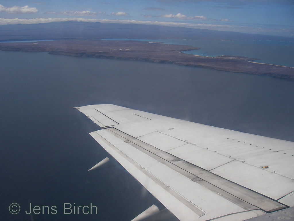 First sight of Baltra island with Santa Cruz in the background.
