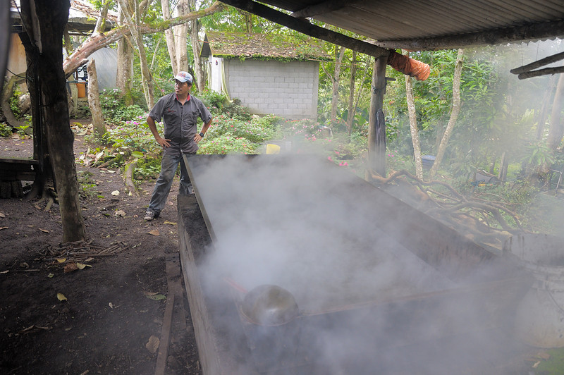 Boiling down the sugar sap to make molasses.