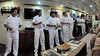 The long white line.  The crew of the Nina toast farewell with pisco sours.