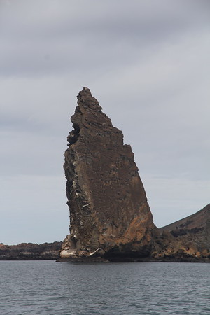 Pinnacle Rock - a spearhead obelisk on Bartholome Island - one of the most famous landmarks in the Galapagos - a black eroded lava formation created when the magma expelled from the volcano reached the sea