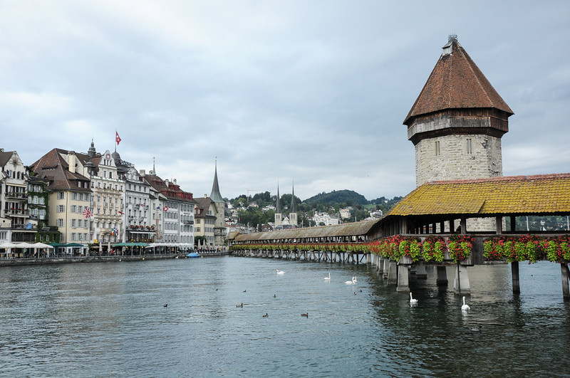 Kappel Bridge  (Chapel Bridge) in Lucern. Built in 1599 it still stands today.  A portion of the bridge was burned and the painting under the covering were destroyed.  They depict the history of the town.