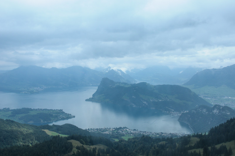 View of Lake Lucern from the top of Pilatus Mountain. People in the middle ages believed a dragon with healing powers and the lake harbors the soul of Pontius Pilate, now at peace.  No one was allowed to  climb the mountain should they disturb the soul of Pilate.  Now there is a motel, hiking trails and ascent my be taken by the steepest cog wheel train in the world.