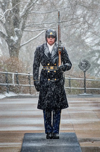 The Old Guard soldiers working in Arlington National Cemetery through a snow storm.