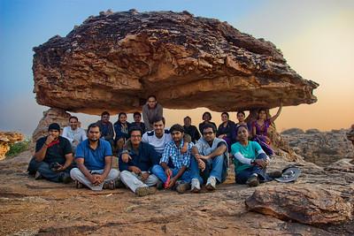 Group shot under an interesting rock.