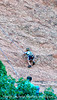 A three-year-old boy climbing on belay on one of the big rock formations in the Garden of the Gods; best viewed in the largest size