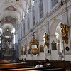 "Peterskirche, Munich. Fodor's guide says: ""The rich baroque interior has a magnificent late-Gothic high altar and aisle pillars decorated with exquisite 18th-century figures of the apostles"".<br /> <br /> (picture taken July 16, 2009)"