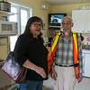 Denise Metatawabin with ferry operator Alexandre Carriere in his office. Photographer captured in batheroom mirror.