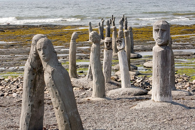 "Le Grande Rassemblement - ""The Great Gathering"" - stonework statues leading into the St. Laurence River at Centre d'Art Marcel Gagnon, Sainte-Flavie, Gaspésie, Quebec, Canada."