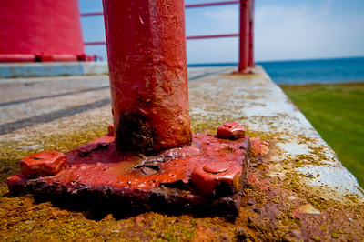 Part of the base of a handrail... over the years, it's built up quite a few layers of rust and paint.