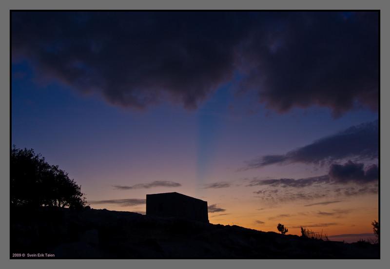 FArmhouse silhouette - blue stripe from a cloud