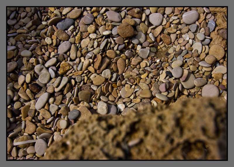 Ground structure - pebbles from layered rock