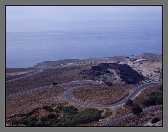 Going there - The road across the Lefka Ori mountains meanders down to Chora Sfakion, where the ferry trip starts. Gavdos can be seen as a low shape in the upper left corner of this image.