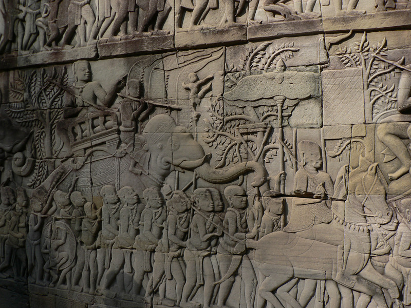 The lower level of the Bayon has marvellous bas relieves all around.  These are battle scenes.