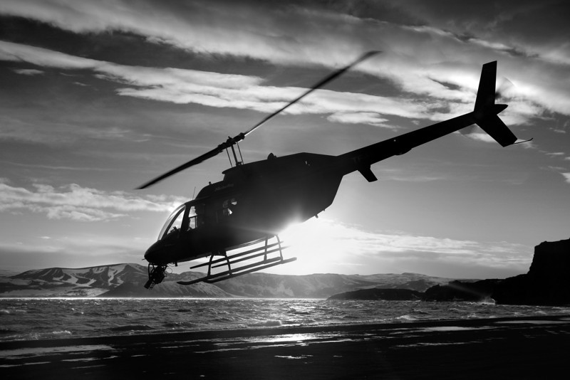Helicopter silhouetted against the sun.