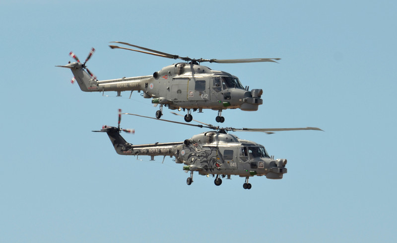 SOUTHPORT, ENGLAND - JULY 23: Two Royal Navy Black Cats Lynx helicopters perform aerobatics and mid air stunts on July 23, 2011 in Southport, England.