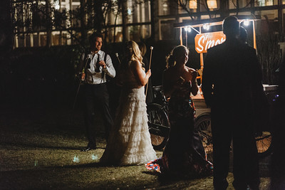 Remembering when the bride toasted s'mores at midnight in her wedding dress