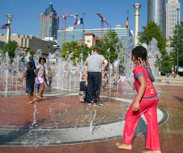 Keds cool off in the Centennial Olympic Park Fountain