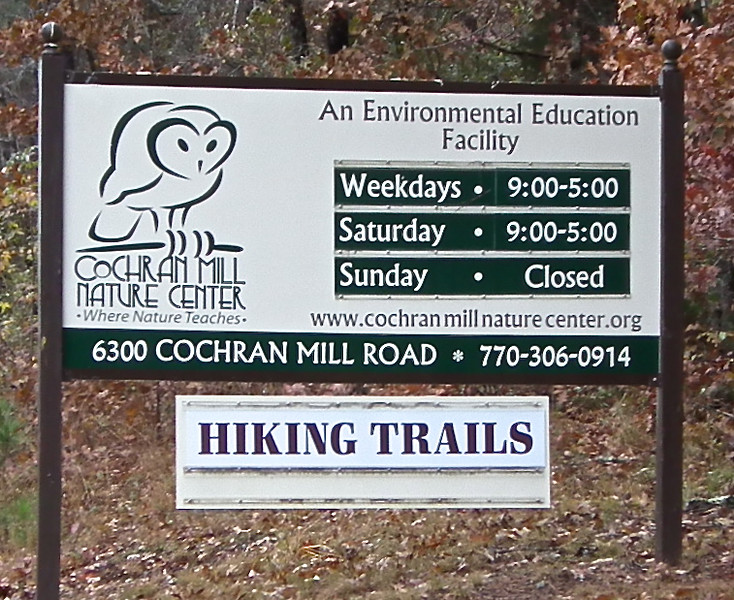 Entrance Sign - Cochran Mill Nature Center<br /> This place takes in wildlife pets that people no longer want or non-releaseable wildlife that may have been injured beyond total repair. In the late 1980's, a small group of local residents with a shared passion for the environment believed they could strengthen their community through environmental education and conservation. They secured a 45-year lease on approximately 50 acres of privately-owned land adjacent to Cochran Mill Park, an 800-acre nature preserve owned and managed by Fulton County. This property has become the home of Cochran Mill Nature Center, a private, non-profit organization providing environmental education and wildlife rehabilitation services.  The ongoing support and commitment of the community made it possible for the Nature Center to provide year-round educational programming since 1991.