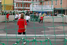 Kids playing a soccer game on a hastily created urban field in Würzburg (for a pre-easter festival near the town square.)