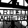 """Arbeit macht frei"" translates to ""Work sets you free""."