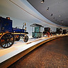 A procession of vehicles made by Gottlieb Daimler and Karl Benz in The Invention of the Automobile Legend Room.