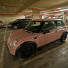 A stylish Mini Cooper in the Ring garage.