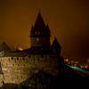 Burg Stahleck in the fog, lit up by the lights from Bacharach below.
