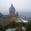 Burg Stahleck sits on a hill with Bacharach and the Rhine River below.