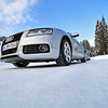 The Audi A5 sportback under a clear, blue Austrian sky.