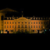 The Electoral Palace, built in the 17th century, lit up at night.