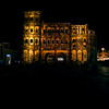 The Porta Nigra lit up at night.