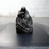 "Berlin - This famous Käthe Kollwitz statue is located inside the Neue Wache in the previous photo, which depicts a Mother holding her dead Son.  An approximate translation of the inscription is ""The Sacrifice Of War and Violent Domination""."