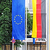 Worms, Germany, July 2012. The European Union (L) and Reunified Germany flags.