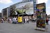 Fragment of The Berlin Wall and Giant billboard Potsdamer Platz Berlin
