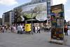 Fragment of The Berlin Wall and Giant billboard Potsdamer Platz Berlin