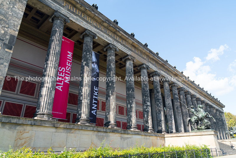 BERLIN, GERMANY - AUGUST 28, 2017; Exterior colonade of historic Altes Mueum on Musium Island in middle of city with statues of Lion Fighter on horseback by Albert Wolff guarding the entrance steps.