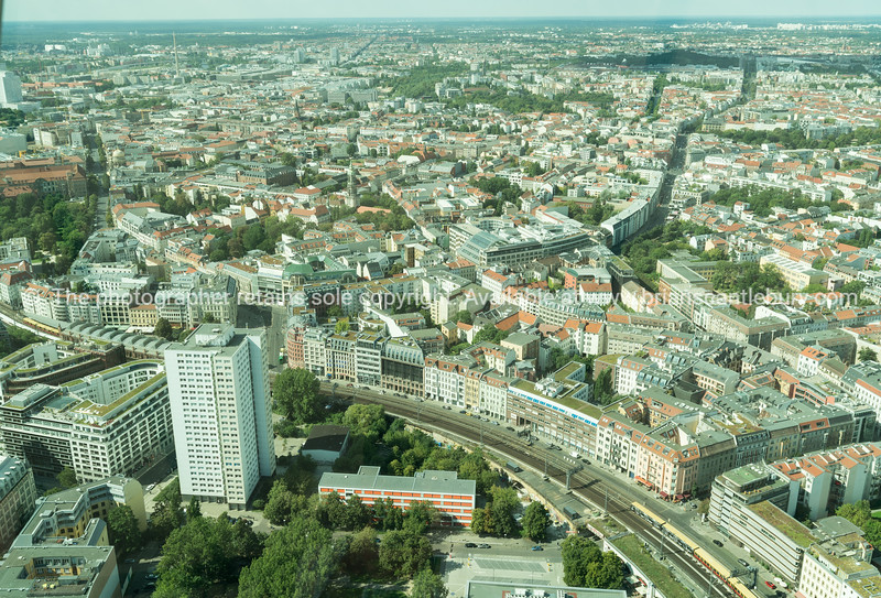 BERLIN, GERMANY - AUGUST 28 2017;  ciryscape with  S-Bahn commuter rail-line snaking through the cityscape viewed from the Fernesturm TV tower.
