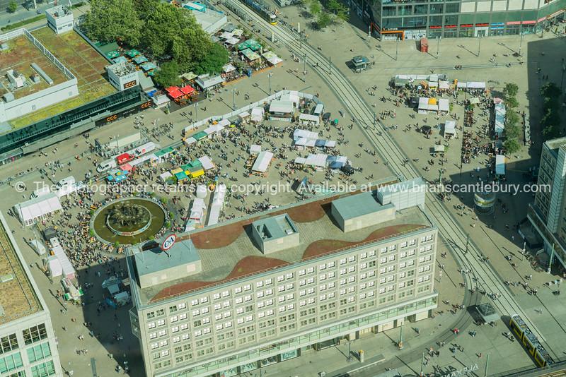 BERLIN, GERMANY -AUGUST 28, 2017; Aerial of city street scene with people wandering Alexandra Platz weekend Market
