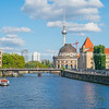 tourists on river cruises though Berlin on River Spree.