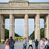 woman takes selfie in front of Brandenburg Gate
