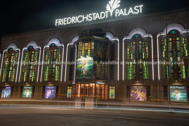 Colorfully illuminated stained galss windows and neon sign of historic FriedrichStadt Theater