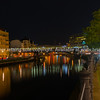 Spree Canal in Berlin night effect from lights over bridge on Freidrichstrasse , Germany.