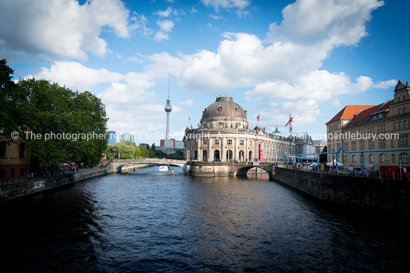 Baroque architectural exterior of Bode Museum, from northern end of Museum Island surrounded by River Spree.