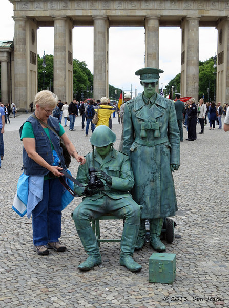 Brandenburg Gate, Berlin, May 29, 2013. We thought they were statues. Pat's certainly surprised he took her camera.