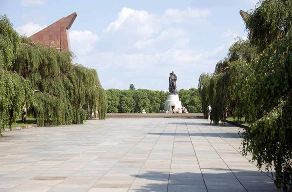 1941 - 1945 Soviet war memorial, Treptower Park, east Berlin, 4 June 2016.  Looking past the two portals to the monumental figure of a Soviet hero.